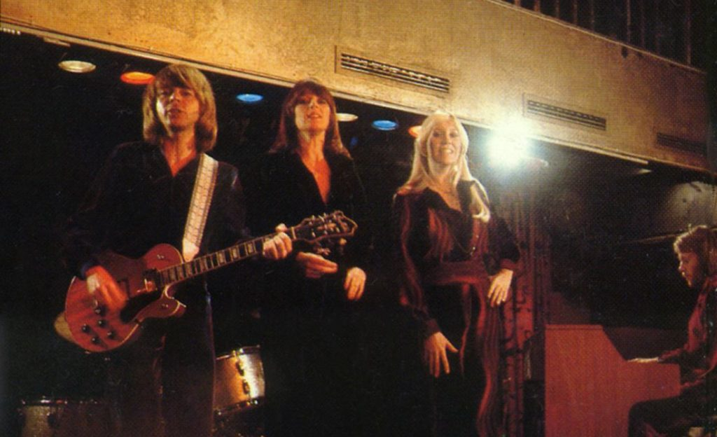 ABBA with a hagstrom guitar