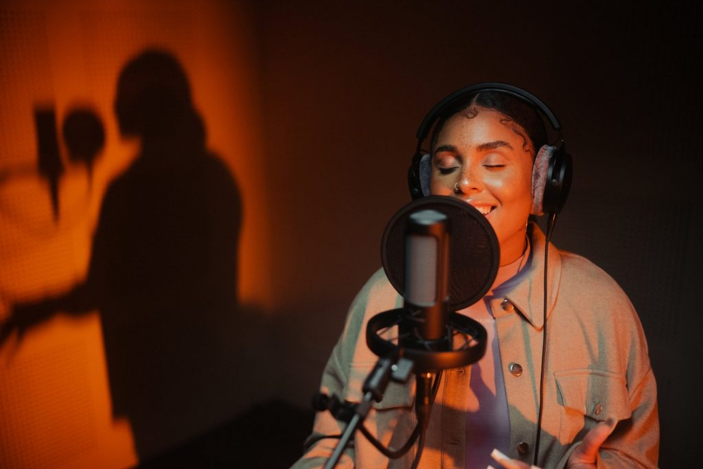 person singing into and wearing Beyerdynamic PRO X products