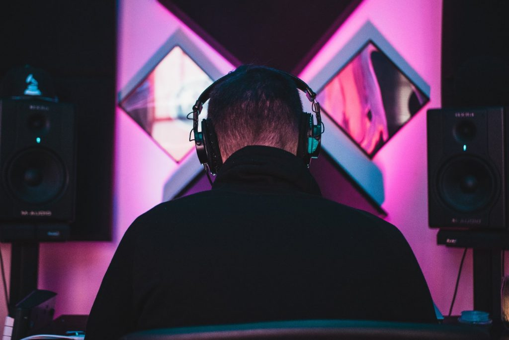 Person listening to music in colourful studio