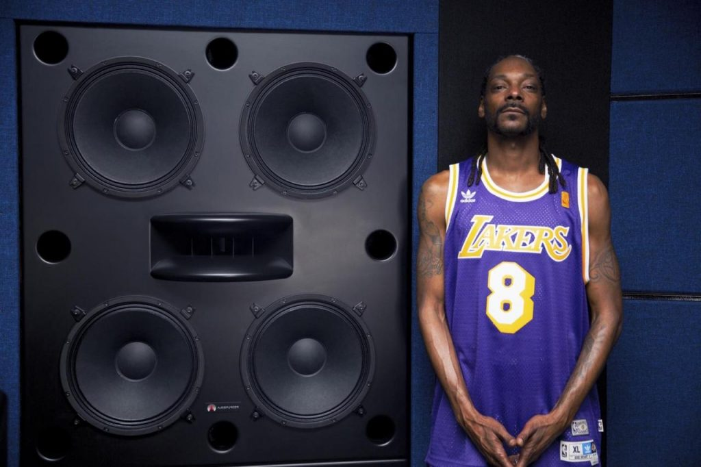 Snoop Dogg in lakers jersey in front of Augsperger monitor speakers